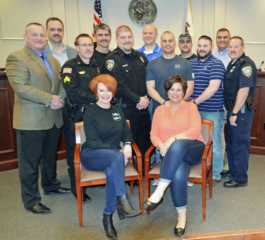 A few of the people participating in Mustache March 4 PD to raise funds for area police, include from front left, committee members Vicki Hosto and Joell Aguirre; second row, Jerseyville Deputy Chief of Police Scott Woelfel, JPD Sgt. John Lawson, Alton Police Department patrolman Elliott Fergurson, APD Det. Jim Siatos, APD Sgt. Jeremiah Dressler, and Wood River Police Department officer Chris Alfaro; back row, JPD Chief of Police Brad Blackorby, committee chair Steve Schwegel, president of the Police Benevolent and Protective Association Alton Unit 14 and APD Det. Andrew Pierson, APD canine handler Mike Morelli, and committee member Johnny Aguirre. Photo: Vicki Bennington | For The Telegraph
