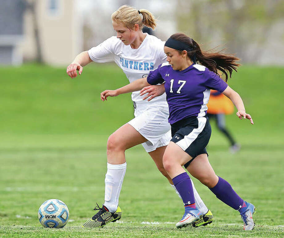 Jersey's Erica Bechtold, left, and Mascoutah's Justine Kapp battle for the ball during Tuesday's Oilers Soccer Tournament match played at Wood River Soccer Park. Mascoutah edged Jersey 2-1 in overtime. Photo: Billy Hurst | For The Telegraph