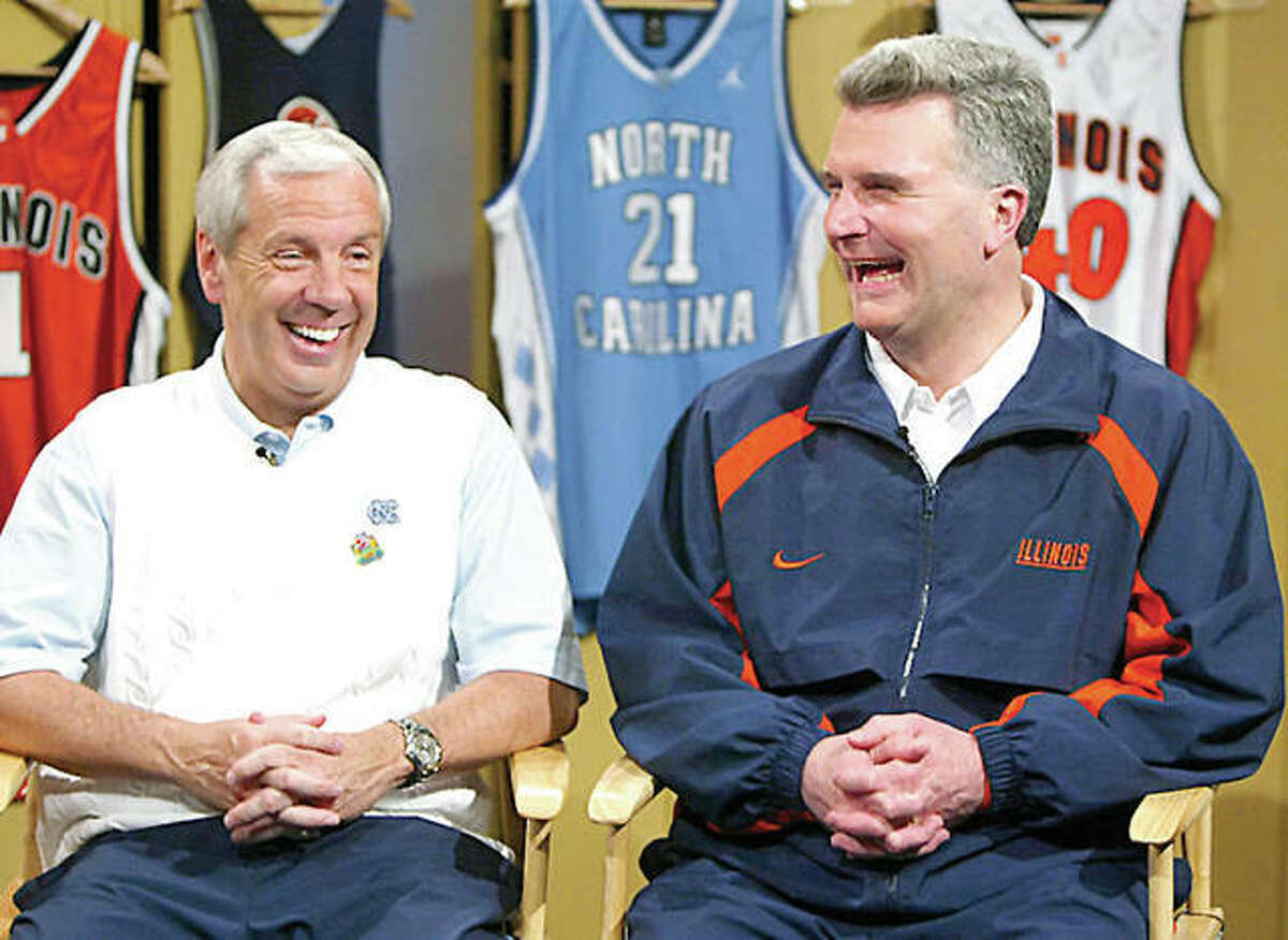 North Carolina coach Roy Williams, left, and former Illinois coach Bruce Weber laugh as they meet with reporters prior to the 2005 national championship game in St. Louis. UNC beat the Illini for the title at the Edward Jones Dome.
