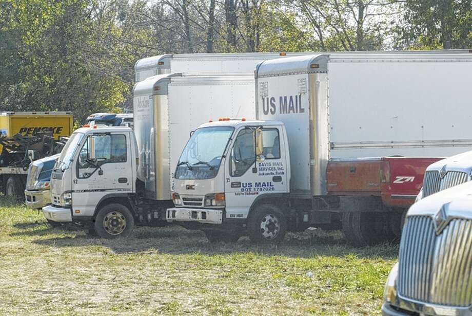 The view of the allegedly dillapidated trucks, target of a White Hall ordinance violation, from a neighboring property on West Bridgeport Street. Photo: Nick Draper | Journal-Courier