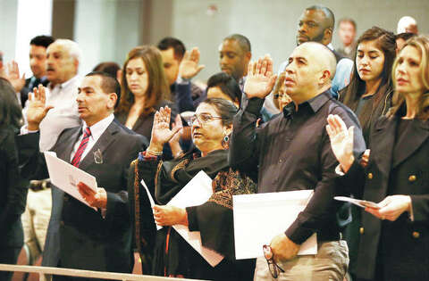 American made: Alton High welcomes new citizens at