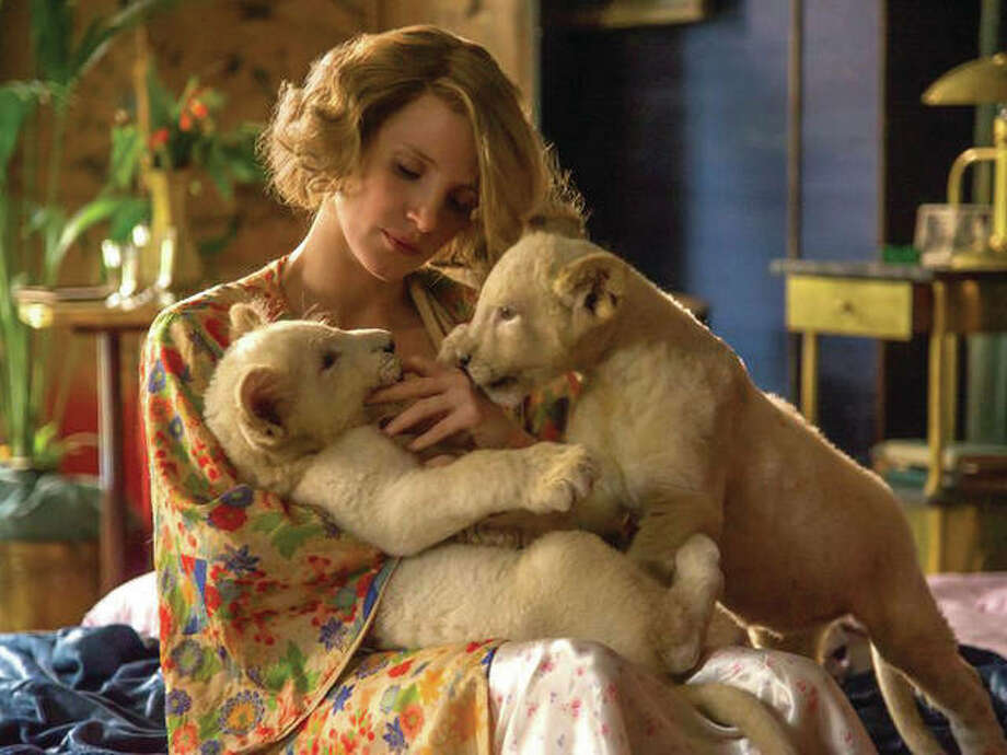 """Academy Award-nominee Jessica Chastain stars as the zookeeper's wife, Antonina Zabinski (shown here). """"The Zookeeper's Wife"""" tells the true story of zookeepers of the Warsaw Zoo, Antonina and Jan Zabinski, who helped save hundreds of people and animals during the Nazi invasion of Poland. Photo: (Anne Marie Fox/Focus Features Via AP)"""