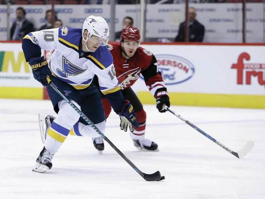 The Blues' Scottie Upshall (left) skates away from Arizona's Anthony DeAngelo in the first period of Wednesday night's game in Glendale, Ariz. The Blues won 3-1. Photo: Associated Press
