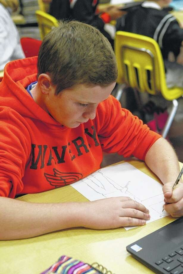Waverly eighth-grader Jimmy Cummins works on the thumbnail of his art project Monday during class. Student work will be sold to raise money for veteran's services. Photo: Samantha McDaniel-Ogletree | Journal-Courier