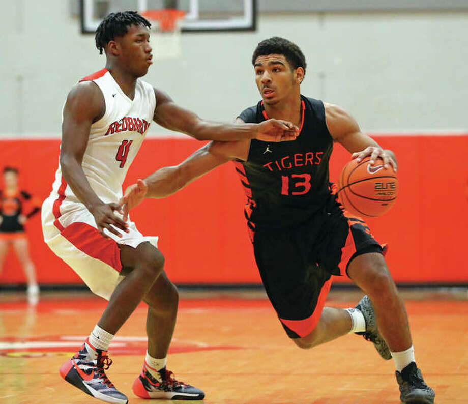 Edwardsville's Mark Smith (right) drives on Alton's Terrance Walker during a Southwestern Conference game Jan. 24 at Alton High in Godfrey. Smith, Mr. Basketball and the Gatorade Player of the Year in Illinois, is entering a stretch run of a process that has made him one of the nation's most prized recruits. Photo: Billy Hurst / For The Telegraph