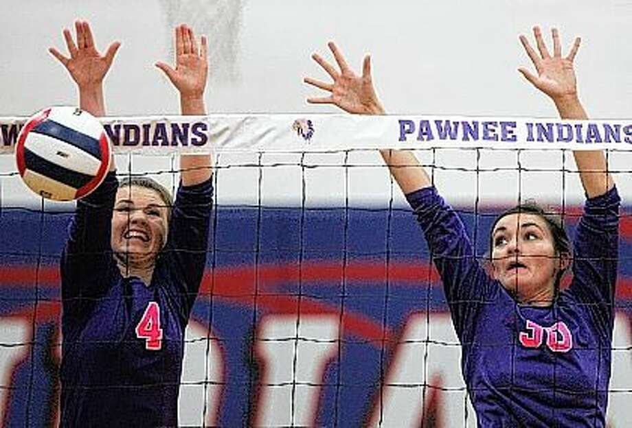 Routt's Maddie Nelson (left) and Marie Langdon go up for a block during a match against Raymond Lincolnwood in the semifinals of the Pawnee Sectionals Tuesday night. Photo: Dennis Mathes | Journal-Courier