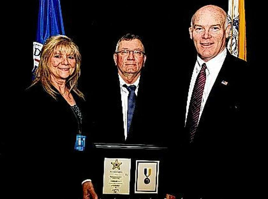 Jacksonville resident Joseph W. Patty (center) stands with his wife, Connie, and Secret Service Director Joseph Clancy after receiving a 2015 Director's Lifesaving Award. The award acknowledges Patty's efforts to save the life of a man involved in an accident along an interstate in Ohio in 2014. Patty, 61, has worked as a telecommunications specialist for the Secret Service for about eight years. Photo: Submitted Photo