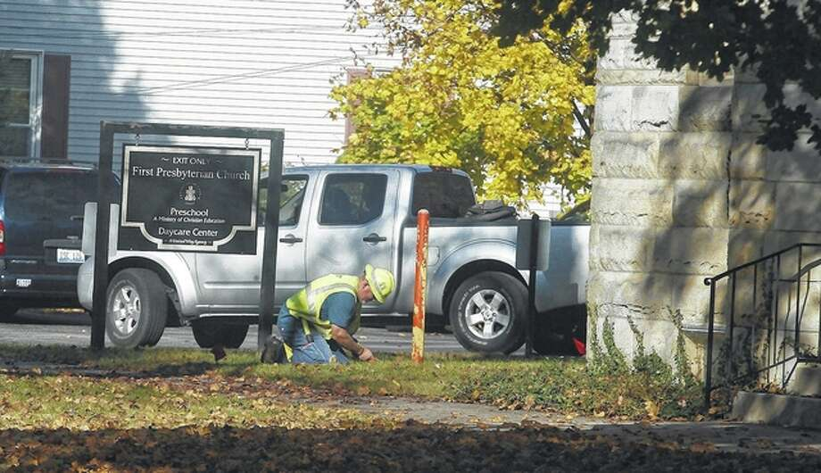 An Ameren worker tries to shut off a natural gas line at First Presbyterian Church in Jacksonville after the pipe was hit Wednesday, causing a brief gas leak. Photo: Samantha McDaniel-Ogletree | Journal-Courier