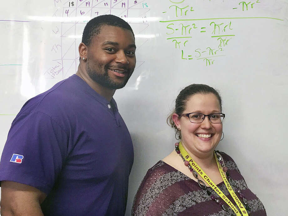 Submitted photo Eight Points Charter School math teacher Beth Simler (right) has been nominated for Renaissance Learning's Distinguished Teacher Award. Simler is assisted by Martez Turner.