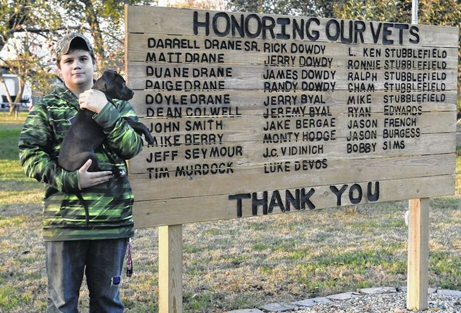 Joe Drane stands near the sign he and his father, Darrell, and others helped make to honor veterans. Photo: Nick Draper | Journal-Courier