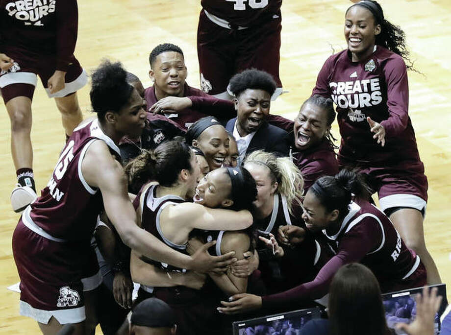 Mississippi State's Morgan William (center) celebrates with teammates after she hit the winning shot at the buzzer in overtime to defeat Connecticut in an NCAA women's semifinal at women's Final Four on Friday night in Dallas. Photo: Associated Press
