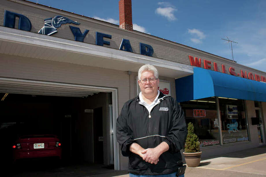 Alex Heeb/The Telegraph Mike Norris of Wells-Norris, Inc. stands in front of his family business, which is turning 90 years old. The shop has been at its current location since 1931.