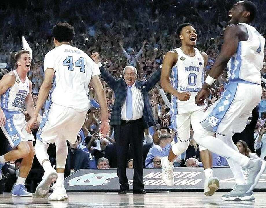North Carolina head coach Roy Williams and players celebrate their 71-65 win over Gonzaga in Monday night's NCAA championship game in Glendale, Ariz. Photo: AP