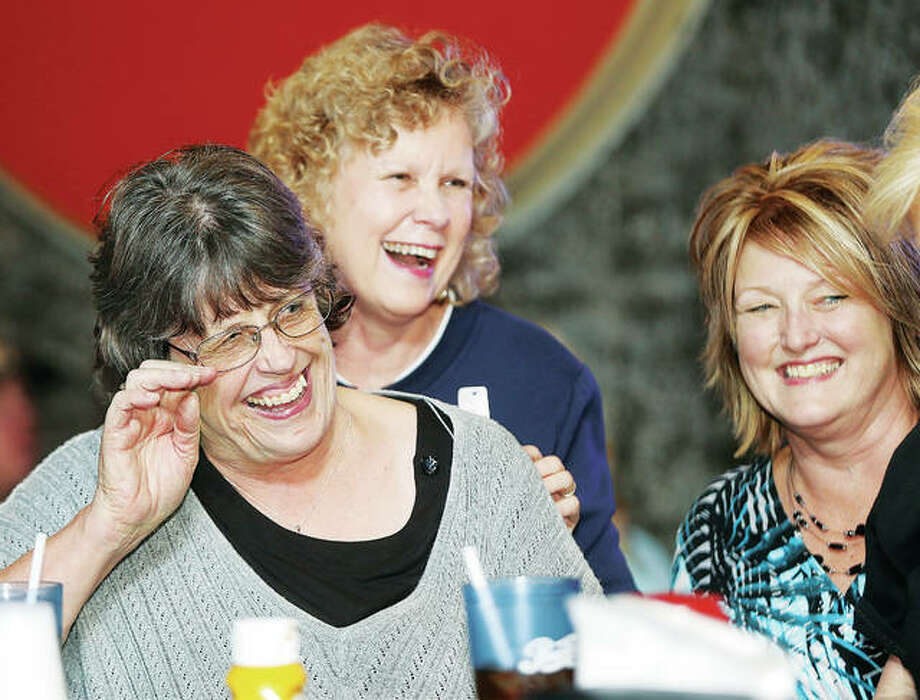 Wood River mayoral candidate Cheryl Maguire, left, enjoys a laugh with friends Tuesday night at the Airliner Bar and Grill in Rosewood Heights as election results drew to a close. Maguire will be the first female mayor in Wood River's history after she defeated three other hopefuls in Tuesday's consolidated election. Photo: John Badman | The Telegraph