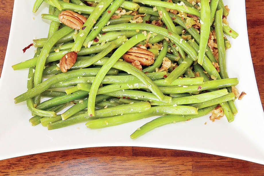 Green beans with pecans can be an unexpected treat for Thanksgiving. Photo: Bob Donaldson | Pittsburgh Post-Gazette | TNS