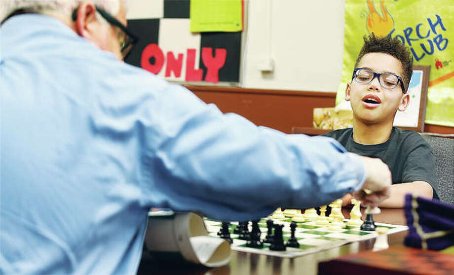 Isaiah Stueckel, 10, reacts as his chess teacher, John Sholar, takes one of his pieces in a chess game at the Boys & Girls Club of Alton, which is about to celebrate their 20th anniversary. Sholar volunteers to teach interested students chess, a game that requires great concentration and learning the strategy of thinking ahead. Photo: John Badman|The Telegraph