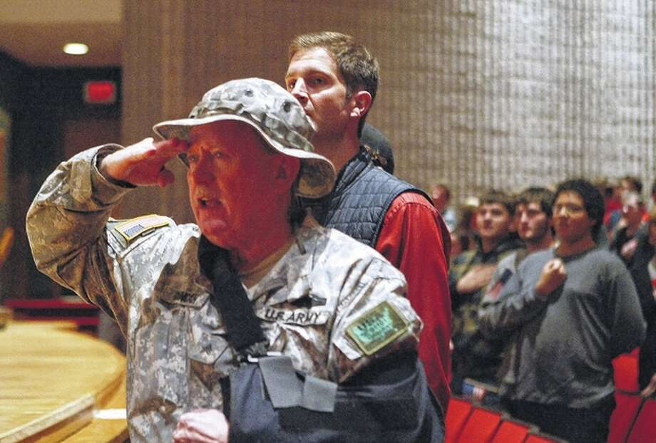 Jim Duncan, commander of Jacksonville AMVETS Post 100, salutes the flag during a Veterans Day program Tuesday at Jacksonville High School. Photo: Samantha McDaniel-Ogletree | Journal-Courier