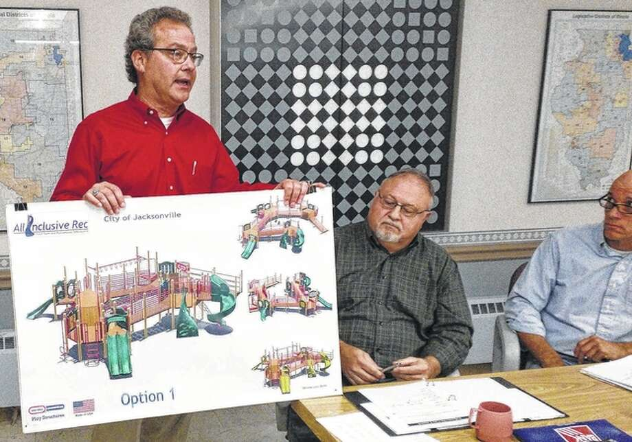 Jacksonville Parks and Lakes Director Kelly Hall shows the plans for a new playground structure that may come to Community Park. Photo: Nick Draper | Journal-Courier
