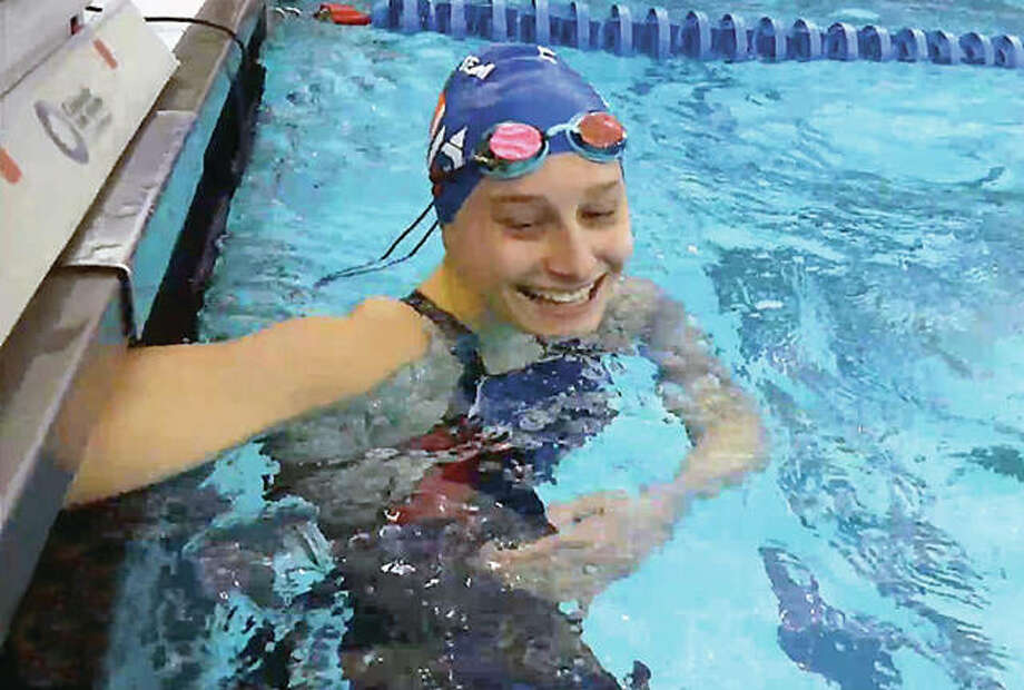 Bailey Grinter of the Edwardsville YMCA Breakers smiles after she won the 50-yard freestyle national championship at the YMCA Short Course Nationals Thursday in Greensboro, North Carolina. Photo: USA Swimming Screen Image