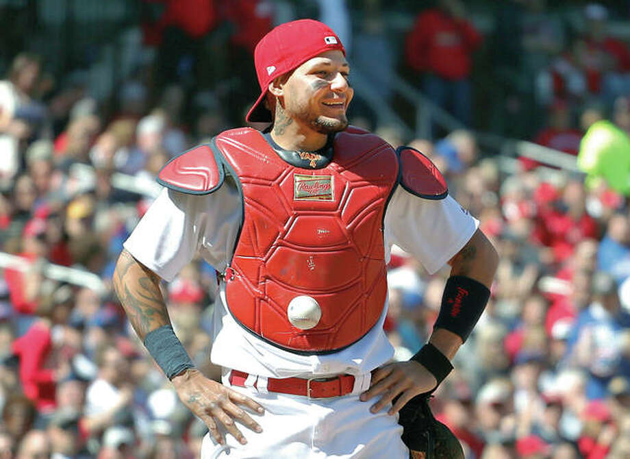 Cardinals catcher Yadier Molina stands with his hands on his hips as a ball is somehow stuck to his chest protector during the seventh inning of Thursday's game against the Cubs at Busch Stadium. The ball was stuck to Molina's chest protector on a dropped third strike allowing the Cubs' Matt Szczur to reach first base when Molina couldn't find the ball. Photo: AP