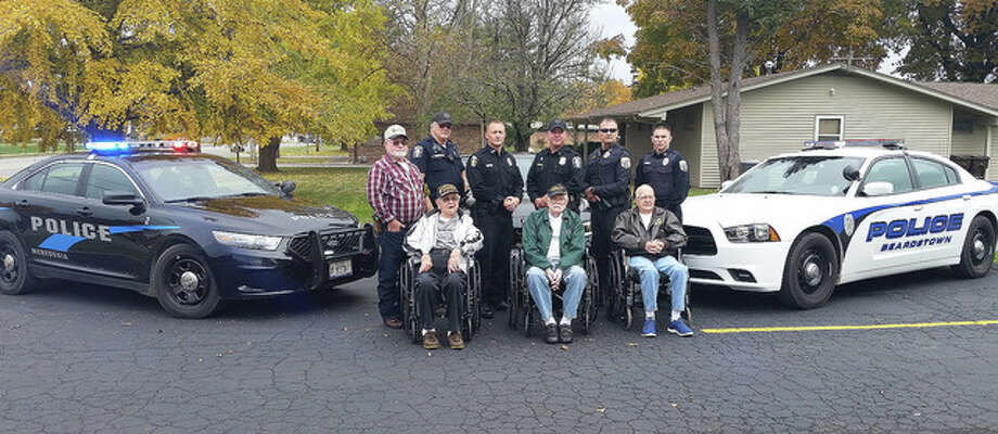 "Photo courtesy of Debbie Carnes Army veteran Howard Johnson (front row, from left) and Navy veterans Kenney Kunkel and Wayne ""Bob"" Kehl join with Navy veteran Phillip Williams (back row, from left), Meredosia Patrolman Richard Pulling, Meredosia Patrolman Jarred Hester, Meredosia Police Chief Curtis Williams, Beardstown Police Chief Dustin Clark and Beardstown Patrolman Chase Fox following a Veterans Day lunch. Pulling is a Navy and Air National Guard veteran, Hester is a Marine Corps veteran, Williams and Clark are Army veterans and Fox is a Marine Corps veteran."
