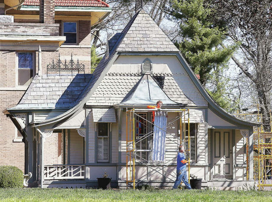 Employees of Renaissance Roofing Inc. in St. Louis erect scaffolding Friday morning before starting the job of removing the original 132-year-old slate roofing from the historic Haskell Playhouse on Henry Street in Alton. The job will cost $36,000 and take a few weeks to complete.