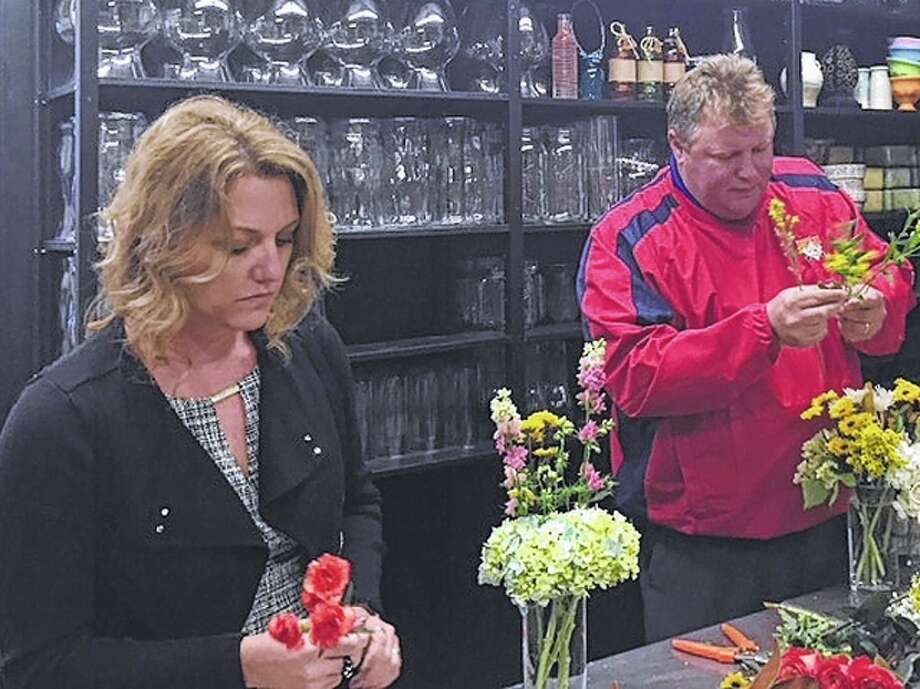 After a ribbon cutting at Ashley's Petals and Angels this week, owner Lori Wankel had Jacksonville Area Chamber of Commerce President Lisa Musch and Jacksonville Mayor Andy Ezard create their own bouquets from start to finish. Photo: Vicki Selby | Journal-Courier