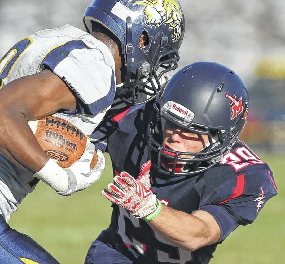 MacMurray College's Cash Owsley closes in for a tackle during a game against Maranatha Baptist University Saturday in Jacksonville. Photo: Dennis Mathes | Journal-Courier
