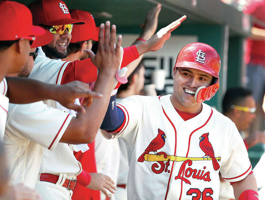 The Cardinals' Aledmys Diaz is congratulated by teammates after hitting a three-run home run in the fourth inning against the Reds Saturday in St. Louis. Photo: AP