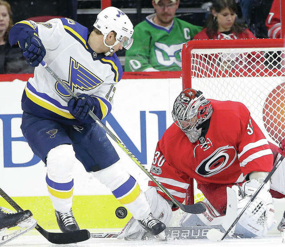 The Blues' Jaden Schwartz is blocked by Carolina Hurricanes goalie Cam Ward (30) during the second period of Saturday's game in Raleigh, N.C Photo: AP