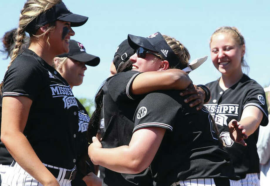 Mississippi State senior Alexis Silkwood (center, right) is embraced by a teammate after Silkwood posted her school-record 56th win in the Bulldogs SEC softball victory Saturday in Starkville, Miss. Silkwood, from East Alton, is also the Illinois high school state record-holder in wins with 124 from four seasons at Marquette Catholic. Photo: MSU Athletics
