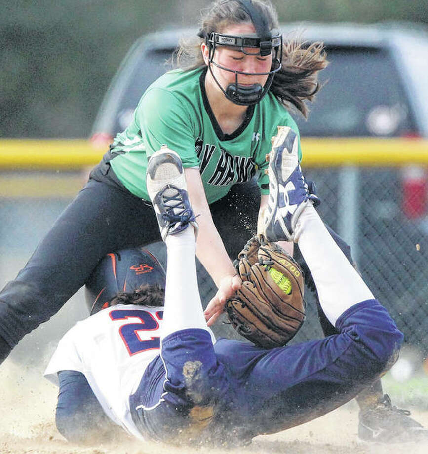 An Illini West player slides safely into second base under the tag by Carrollton's Claire Williams during the championship game of the Beardstown Tournament on Saturday afternoon in Beardstown. Photo: Dennis Mathes / Journal-Courier
