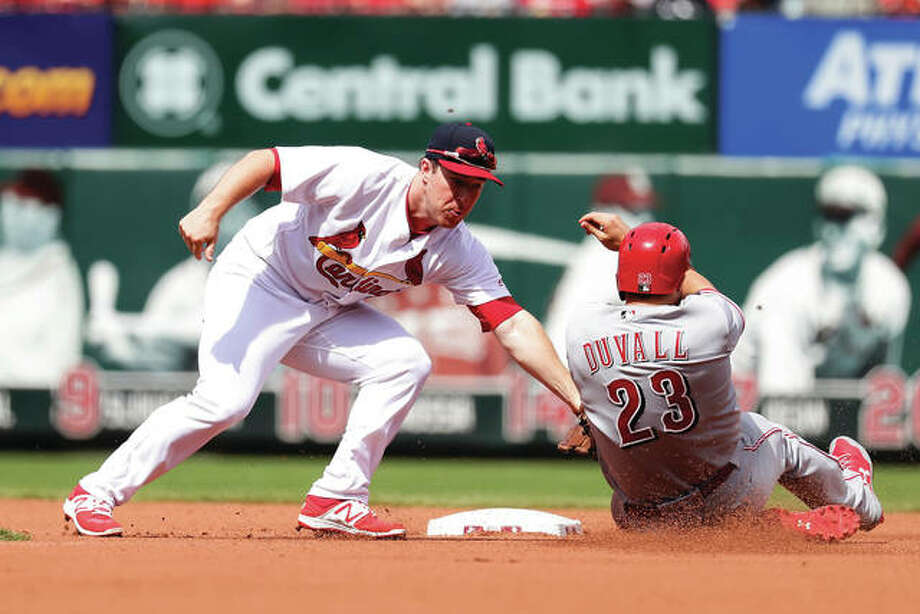 The Reds' Adam Duvall (right) is tagged out trying to steal by Cardinals second baseman Jedd Gyorko during the fourth inning Sunday at Busch Stadium. Photo: Associated Press
