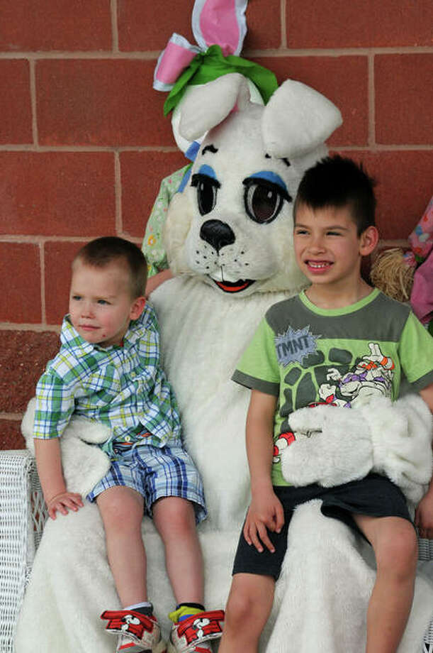 Three-year-old Jeffery Magdaleno of Cottage Hills and his 6-year-old brother Chris pose with the Easter Bunny during Sunday's Easter Egg Hunt at Godfrey's Glazebrook Park.