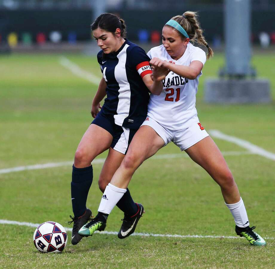O'Connor's Katerina Clukey (14) shields the ball from Brandeis' Kelli Diaz (21) during their game at Northside ISD Soccer Field on Friday, Feb. 9, 2018. O'Connor upset Brandeis 2-1. Photo: Kin Man Hui, San Antonio Express-News / ©2018 San Antonio Express-News