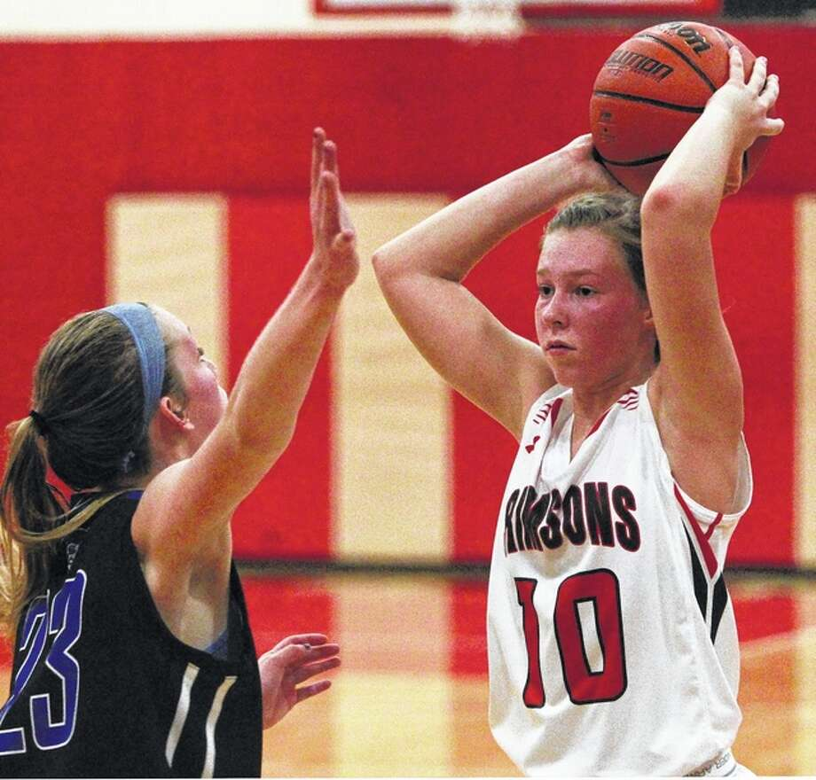 Jacksonville's Daisy Wood looks for an open teammate during a basketball game against Quincy Tuesday in Jacksonville.