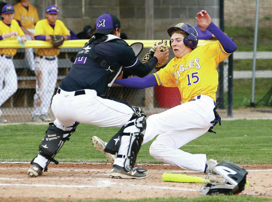 Civic Memorial's David Lane (right) is tagged out at the plate by Mascoutah catcher Sam Scott during Monday's Mississippi Valley Conference baseball game at the Bethalto Sports Complex. Mascoutah won 7-4 in the Valley opener for both teams. The Indians, seeking their first MVC championship since 2014, improve their record to 11-1. CM, which shared the Valley title with Highland and Waterloo in 2015, is 9-5 under first-year coach Nick Smith. The Eagles, who had won five of their last six games, play on the road at Marquette Catholic on Tuesday and Jersey on Wednesday.