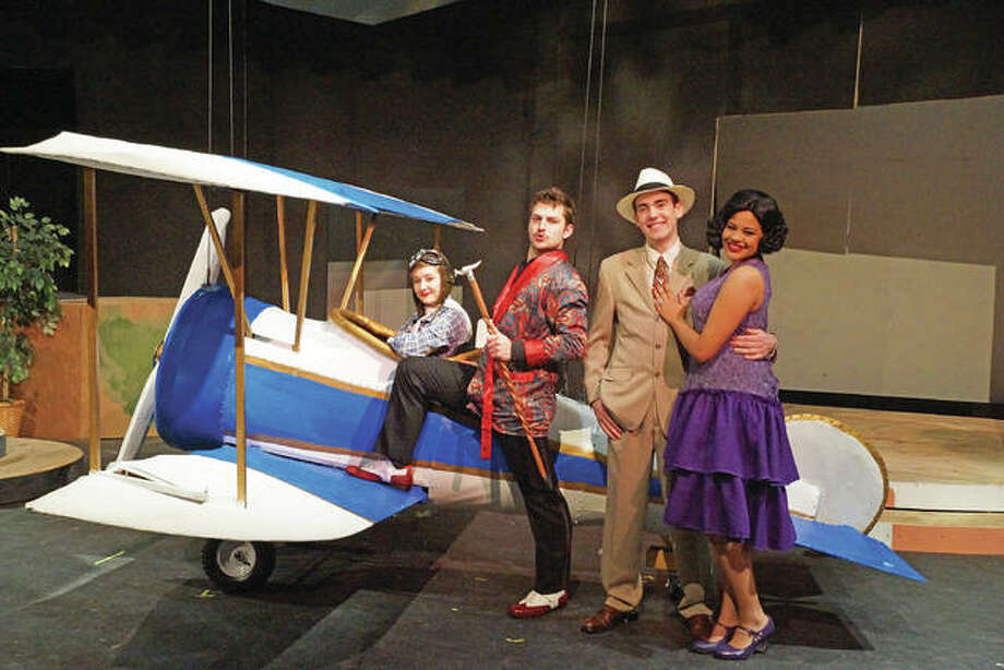 "Zora Vredeveld (Trix), from left, Oliver Bacus (Aldolpho), Brandon Janssen (Robert), and Maika Miller (Janet) surround the airplane known as ""The Amelia"" in Southern Illinois University Edwardsville's production of ""The Drowsy Chaperone."" Photo: Valerie Goldston/For The Telegraph"