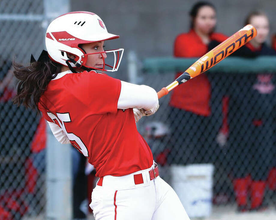 Alton's Miranda Hudson, shown hitting a two-run double during a win over Bunker Hill on March 22 at Alton High, is among the Southwestern Conference's leaders in batting average, RBIs and home runs after a torrid start in March. Photo: Billy Hurst / For The Telegraph
