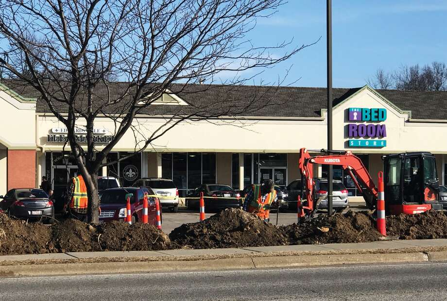 Construction is currently underway in the parking lot of the Montclaire Shopping Center in Edwardsville. The site is set for a renovation for the parking lot, the buildings on the lot, landscaping, lighting upgrades and storm water improvements. Photo: Cody King • Cking@edwpub.net