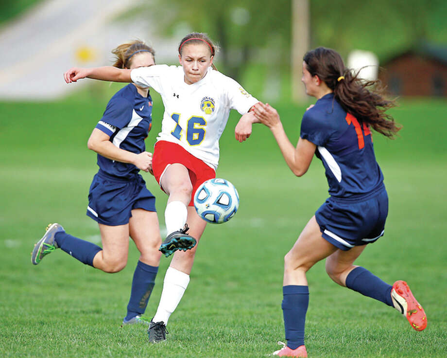 Roxana's Emma Lucas (16) scored her third hat trick of the season and led the Shells to a 5-1 victory over Pana Tuesday in South Central Conference action. Roxana is 6-1 overall and 2-1 in the SCC. She is pictured splitting a pair of Pana defenders last season. Photo: Billy Hurst File Photo | For The Telegraph