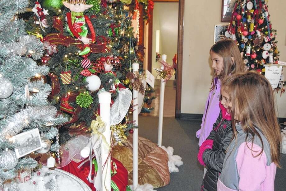 An elf-covered Christmas tree attracted a lot of attention this weekend at the Festival of Trees and Wreaths at the Masonic Center in Jacksonville. Three of the tree's admirers Saturday were Hailey Casey (foreground), 6, Adisyn Tapscott, 9, and Abigail Casey, 8. The tree was designed by Pat Frost and Maxine Likes.