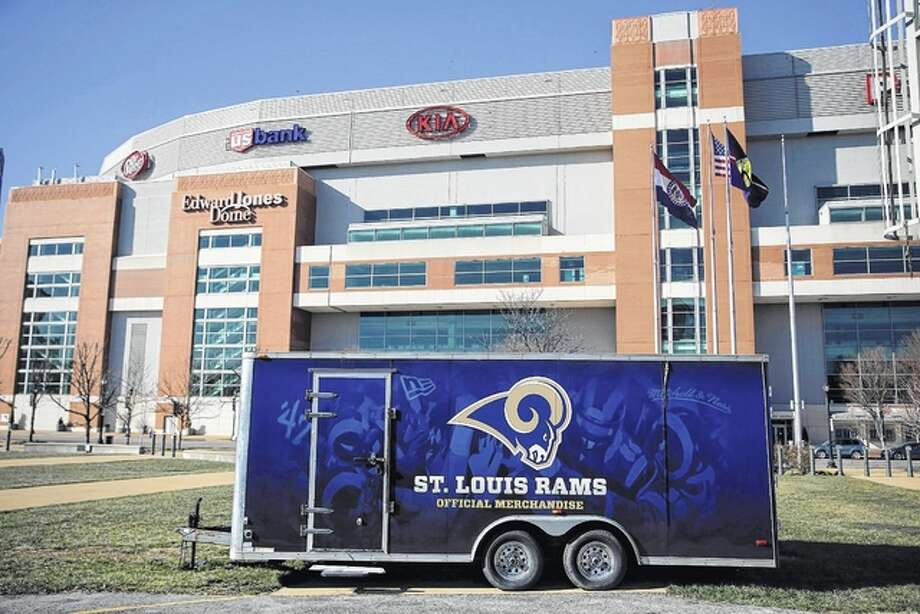 A merchandise trailer sits outside the Edward Jones Dome, former home of the St. Louis Rams, the day after NFL owners voted to allow the team to move back to California. Wednesday, the city of St. Louis filed a lawsuit against the league over the Rams' relocation to Los Angeles, alleging the league violated its own relocation guidelines and enriched itself at the expense of the community it left behind. Photo: AP