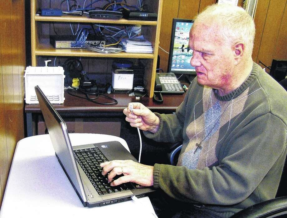 Roger Deem | Journal-Courier Dan Thompson works on trouble-shooting a laptop computer. Adaptive technology has helped him stay up to date in repairing computers.