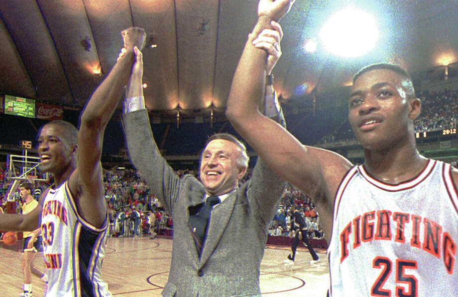 Former Illinois coach Lou Henson, center, celebrates a March, 1989 win with Kenny Battle, left and Nick Anderson Photo: AP File Photo