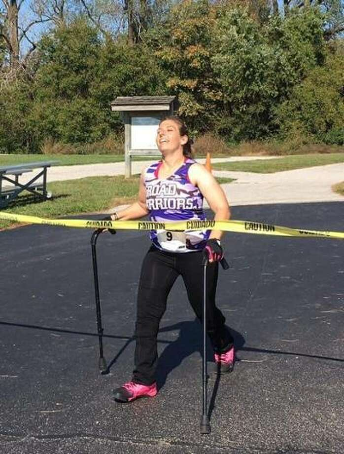 SIUE alumna Tiffany Eickhoff is all smiles as she crosses the finish line during her 10K in October, 2016.