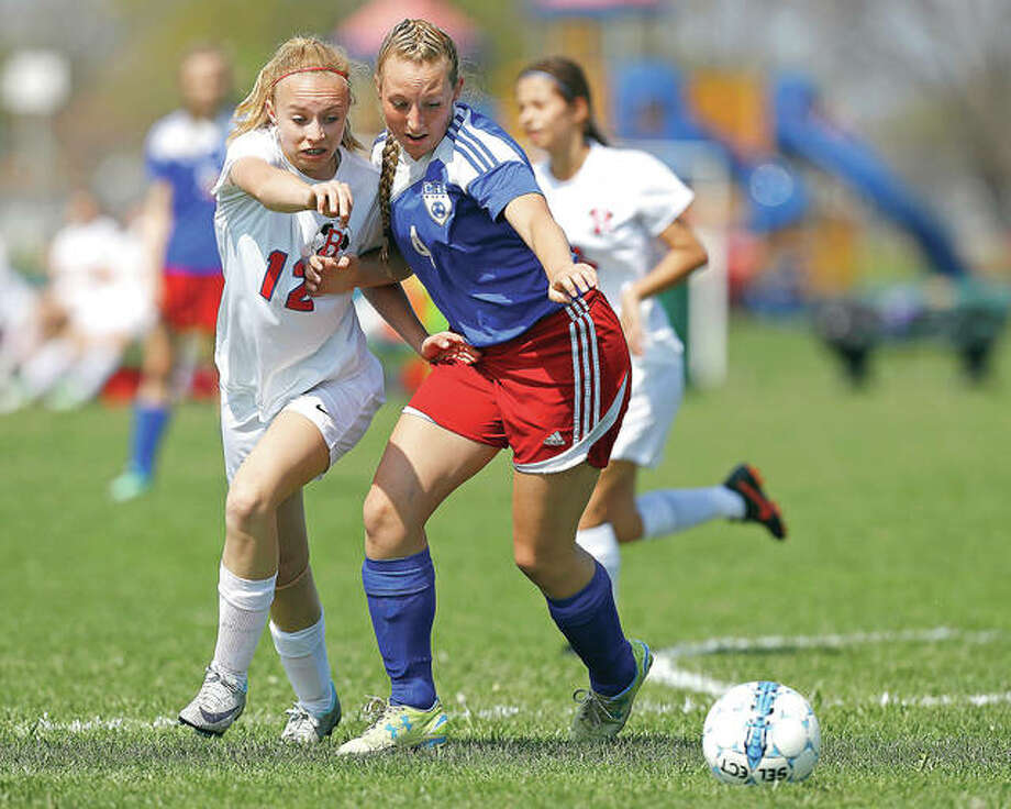Roxana's Bella Scheibe, left, and Carlinville's Marissa Woolfolk battle for the ball during Thursday's match at the Wood River Soccer Park. Photo: Billy Hurst | For The Telegraph