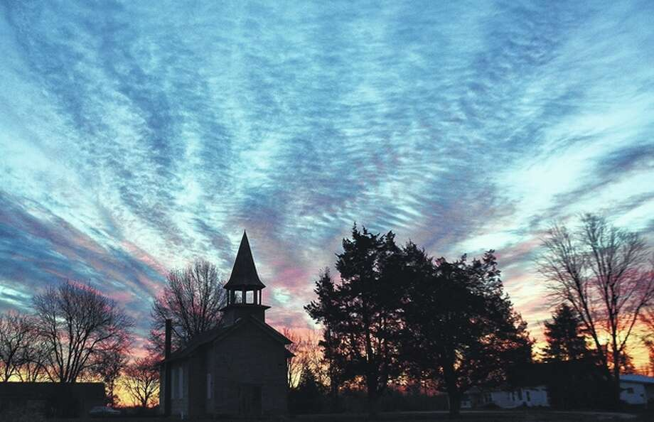 Jeff Ruzicka | Reader photo The sun rises over an old Baptist church in Martinsburg.