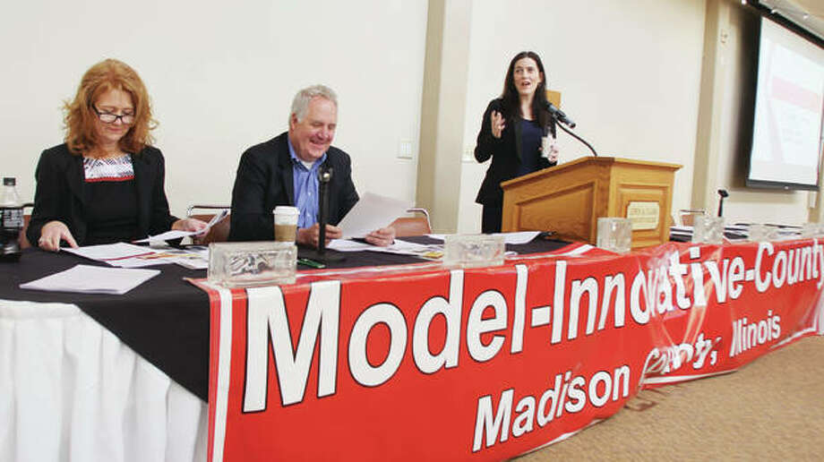 Madison County Community Development Administrator Kristin Poshard, right, speaks at the opening of the Model Innovative County Summit Friday morning at Lewis and Clark Community Colleges N.O. Nelson Campus. Waiting to speak is U.S. Rep. John Shimkus, R-Collinsville, and Mary Lamie, executive director of St. Louis Reigonal Freightway.