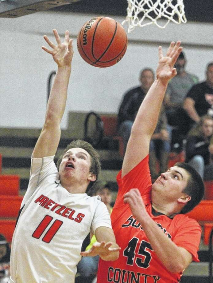 New Berlin's Josh Fuchs puts up a shot as South County's Lewis Wallbaum defends during a basketball game Friday at the Gene Bergschneider Turkey Tournament in New Berlin.